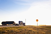 View of truck and stop sign board on highway, Saskatchewan, Canada
