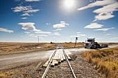 Truck on railway crossing highway 13 West, Saskatchewan, Canada