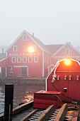 Fog in morning light at Lunenburg Harbour, Nova Scotia, Canada