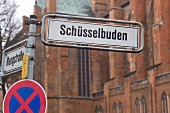 Close-up of signboard of Schusselbuden on street in Schleswig Holstein, Germany