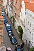 View of town library and cars parked on street, Lubeck, Schleswig Holstein, Germany