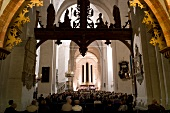 People in music festival at Lubeck Cathedral, Lubeck, Schleswig Holstein, Germany