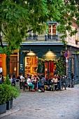 People sitting in Sidewalk in front of cafe, Lyon, France
