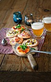 Mini pizzas and beer