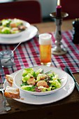 A salad with scallops and beer vinaigrette