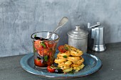 Savoury courgette waffles with a tomato and olive salad