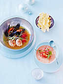 Mussels and langoustines in a curry broth and lobster soup with coconut