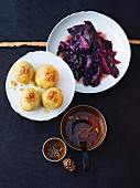 Duck á la orange gravy with potato dumplings and ginger-red cabbage