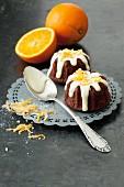 Mini orange Bundt cakes with white chocolate glaze and orange zest