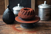 A mini whiskey and chocolate Bundt cake dusted with cocoa powder