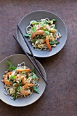 Pad Thai (noodle dish, Thailand) with prawns and mange tout