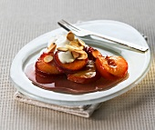 Plums in syrup with cream and slivered almonds