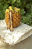 A pineapple filled with peanuts and chilli