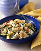 Rigatoni with Zucchini and Summer Squash and Peas in a Blue Bowl