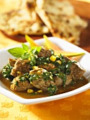 Lamb with spinach and corn sauce