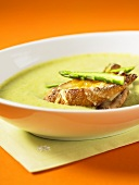 Cream of asparagus soup with cheese croutons