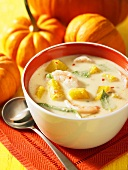 Coconut and pumpkin soup with prawns