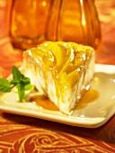A slice of mango cake