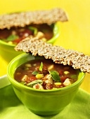 Vegetable soup with turkey and seeded crisp breads