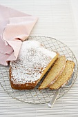 A heart shaped sponge cake dusted with icing sugar, sliced