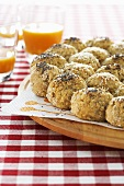 Stuffed bread rolls with poppy seeds and sesame seeds