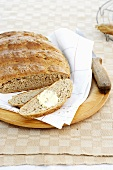 Wholegrain bread, sliced, with butter
