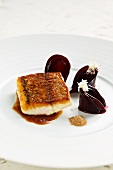 Fried hake with beetroot and must sauce