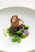Braised Alpine ox with fried goose liver and broad beans