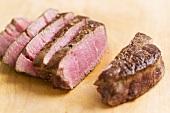 Roast reindeer steak, sliced