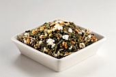 Japanese Gen Mai Cha Loose Green Tea in a White Dish; White Background