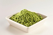 Japanese Matcha Green Tea Powder in a White Dish; White Background