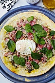 Pizza Topped with Prosciutto, Spinach, Fried Egg and Olive Oil