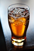 Glass of Beer with Ice Cubes