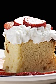 Piece of Tres Leches Cake with Whipped Cream and Strawberries