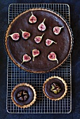 A chocolate and fig tart and two chocolate and fig tartlets