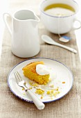 A slice of lemon and polenta cake with cream