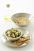 Guacamole with sesame seed crackers