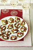 Courgette cakes with goat's cheese and pesto as finger food for a party