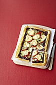 A puff pastry tart with red onions and goat's cheese
