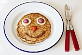A pancake with a funny face