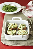 Jacket potatoes with a spring onion and cheese filling