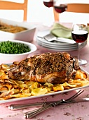 Roast lamb with roast potatoes and peas