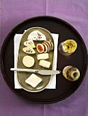 A cheese platter (Harz, Munster, Romadur, Limburg) with figs and white wine