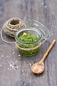 A jar of pesto and a ball of kitchen twine