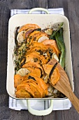 Oven-baked sweet potatoes with herbs
