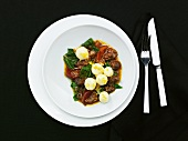 Ox tail ragout with goats cheese and potato gnocchi