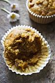 A half eaten carrot muffin