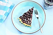 A slice of blueberry tart