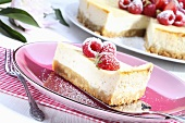 A slice of cheesecake with fresh berries