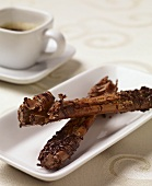 Chocolate Cinnamon Sticks on a White Plate